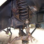 All chassis and suspension components are being cleaned of grease, grit, and rust as shown in this example.  All surfaces are then treated and sealed to prevent further oxidation. Body parts are sprayed with undercoating.  Chassis and suspension parts are painted with a gloss black ceramic paint.