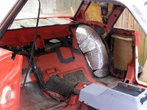 Interior of car has been stripped, de-rusted, and re-primed.